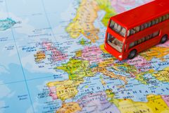Travelling abroad by touristic bus background. Travelling abroad by bus concept. Red doubbledecker on the map, group tour to europe. Tourism and vacation Stock Photos