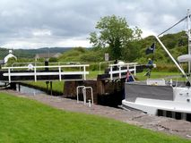 Travelling Along The Crinan Canal. Crinan Canal, Argyll, Scotland has been a working canal since it opened 200 years ago. Connecting canal to lochs and ocean Stock Photos