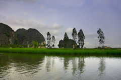 Travelling along rice fields on Tam Coc stream, Ninnh Binh, Viet Stock Photos