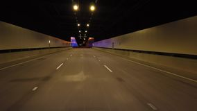 Driving within an underground road tunnel. Travelling along a three lane underground tunnel in the city stock video