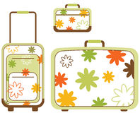 Travelling bags. Flowered in three different sizes of travel luggage Stock Image