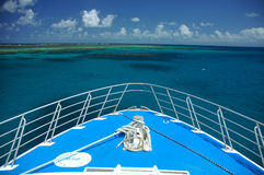 Travelling by boat. Bow of a blue ship, great barrier reef near Cairns, Australia Stock Photo
