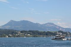 Boat trip on Lake Lucerne. Travelling by boat across the lake in Lucerne, Switzerland Royalty Free Stock Image