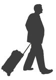 Travelling Businessman. Businessman walking with luggage Stock Image
