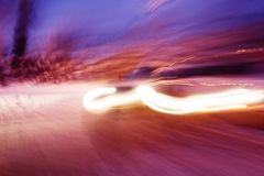 Travelling Car. A abstract blur image of a car travelling at night Stock Image