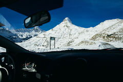 Travelling by car in winter mountains Stock Photography