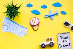 Travelling with child concept. Air balloon, car and plane. Time to travel hand lettering in notebook on yellow. Background top view copy space royalty free stock photos