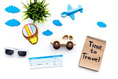 Travelling with child concept. Airplan and car toy, air balloon cookie, airplan tickets. Time to travel hand lettering. Travelling with child concept. Airplan Royalty Free Stock Images