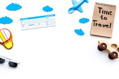 Travelling with child concept. Airplan and car toy, air balloon cookie, airplan tickets. Time to travel hand lettering. Travelling with child concept. Airplan Stock Photo