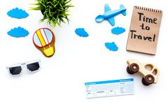 Travelling with child concept. Airplan and car toy, air balloon cookie, airplan tickets. Time to travel hand lettering. Travelling with child concept. Airplan Royalty Free Stock Image