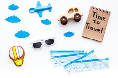Travelling with child concept. Airplan toy, air balloon cookie, airplan tickets. Time to travel hand lettering in. Notebook on white background top view Stock Photo