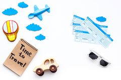 Travelling with child concept. Airplan toy, air balloon cookie, airplan tickets. Time to travel hand lettering in. Notebook on white background top view Royalty Free Stock Image
