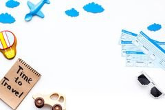 Travelling with child concept. Airplan toy, air balloon cookie, airplan tickets. Time to travel hand lettering in. Notebook on white background top view Royalty Free Stock Photo