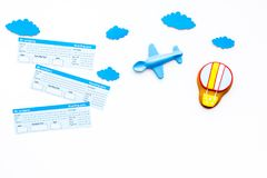 Travelling with child concept. Airplan toy, air balloon cookie, airplan tickets on white background top view copy space. Travelling with child concept. Airplan Stock Images