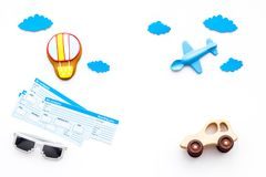 Travelling with child concept. Airplan toy, air balloon cookie, airplan tickets on white background top view copy space. Travelling with child concept. Airplan Royalty Free Stock Image