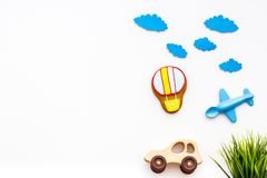 Travelling with child concept. Car and airplan toy, air balloon cookie on white background top view copy space. Travelling with child concept. Car and airplan Royalty Free Stock Images