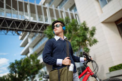 Travelling in the city. College student on bicycle travelling in the city Royalty Free Stock Photos