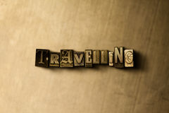 TRAVELLING - close-up of grungy vintage typeset word on metal backdrop Stock Photography