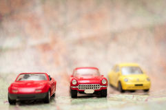 Travelling concept. Travelling by car concept with retro cars on the map Royalty Free Stock Photo