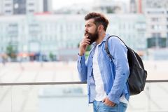 Travelling concept. Tourist on vacation. Hipster modern tourist urban background. Looking for adventures. Tourist. Handsome thoughtful hipster backpack. Man stock photo