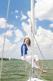 Travelling Concepts: Sensual Caucasian Woman Sailing on Yacht Ou Royalty Free Stock Images