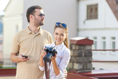 Travelling Concepts. Tourist Couple in Town Outdoors Taking Pictures Stock Photography