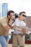 Travelling Concepts. Tourist Couple in Town Outdoors Stock Photography