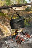 Travelling cooking. Kettle over camping fire Royalty Free Stock Image