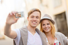 Travelling couple taking photo picture with camera Stock Image