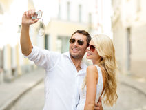 Travelling couple taking photo picture with camera Stock Photography
