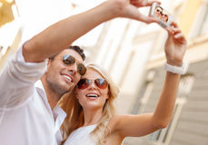 Travelling couple taking photo picture with camera Stock Photos