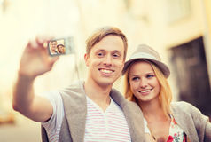 Travelling couple taking photo picture with camera Royalty Free Stock Photo
