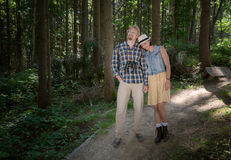 Travelling couple walking together. In summer forest Stock Photography