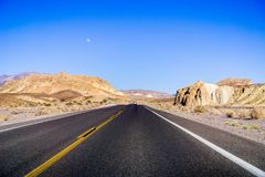 Travelling through Death Valley National Park, moon rising up in the sky; California royalty free stock photos