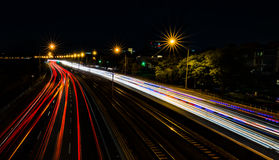 Travelling down the highway at night Stock Image