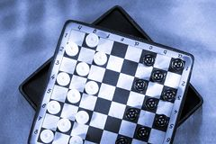 Travelling draughts Stock Images