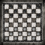 Travelling draughts or checkers on playing field Royalty Free Stock Images