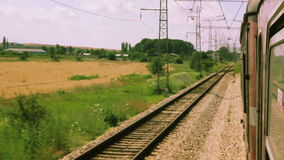 Travelling by European train. Travelling by old European train. Looking out the window at passing scenery stock footage