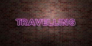 TRAVELLING - fluorescent Neon tube Sign on brickwork - Front view - 3D rendered royalty free stock picture Stock Images