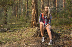 Travelling girl in the forest Stock Photography