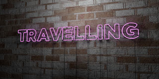 TRAVELLING - Glowing Neon Sign on stonework wall - 3D rendered royalty free stock illustration Royalty Free Stock Photography
