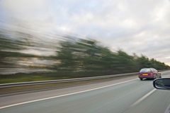 Travelling at high speed on a highway Stock Photo