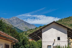 Travelling in Italian Alps - Little alpine town Highly in mountains. Travelling in Italian Alps - Little alpine town house Highly in mountains at hot shiny Stock Image