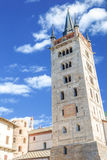 Travelling in Italian Alps - Little alpine town Susa Highly in mountains. Travelling in Italian Alps - an ancient tower in Little alpine town Susa Highly in Stock Images