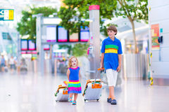 Travelling kids at the airport Stock Photography