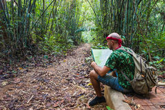 Travelling man sitting in the bamboo forest Royalty Free Stock Image