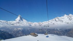 Travelling on Matterhorn Mountain in Swiss royalty free stock images