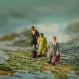 Travelling mini peoples Royalty Free Stock Image