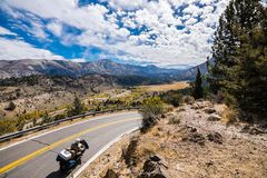 Travelling on a motorcycle towards Sonora Pass. Beautiful alpine valley and mountain ridges visible in the background; Eastern Sierra mountains, California royalty free stock photos