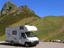 Travelling in motorhome. Motorhome parked at the mountain, near a rocky peak Stock Photo